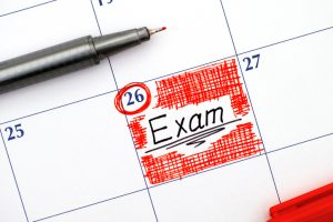 Reminder Exam in calendar with red pen.